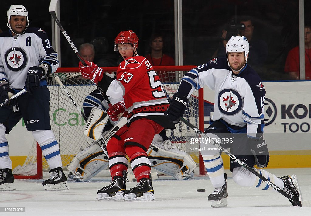 Jeff Skinner #53 of the Carolina Hurricanes creates traffic in front goaltender <a gi-track='captionPersonalityLinkClicked' href=/galleries/search?phrase=David+Aebischer&family=editorial&specificpeople=202976 ng-click='$event.stopPropagation()'>David Aebischer</a> of the Winnipeg Jets during an NHL preseason game on September 25, 2011 at Time Warner Arena in Charlotte, North Carolina.