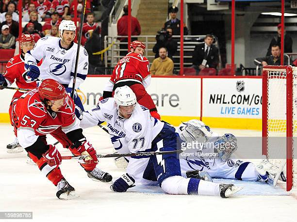 Jeff Skinner of the Carolina Hurricanes flips the puck past Victor Hedman and Mathieu Garon of the Tampa Bay Lightning for a goal during the second...