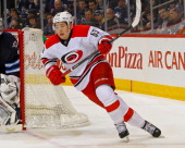 Jeff Skinner of the Carolina Hurricanes follows the play around the net during second period action against the Winnipeg Jets at the MTS Centre on...