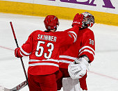 Jeff Skinner of the Carolina Hurricanes gives teammate goalie Cam Ward a face wash following a game against the the Calgary Flames during their NHL...