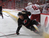 Jeff Skinner of the Carolina Hurricanes goes down while battling along the boards against David Moss of the Phoenix Coyotes during an NHL game at PNC...