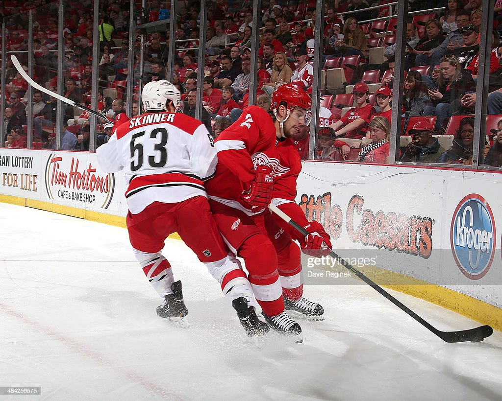 <a gi-track='captionPersonalityLinkClicked' href=/galleries/search?phrase=Jeff+Skinner&family=editorial&specificpeople=3147596 ng-click='$event.stopPropagation()'>Jeff Skinner</a> #53 of the Carolina Hurricanes hits Brendan Smith #2 of the Detroit Red Wings in the corner during an NHL game on April 11, 2014 at Joe Louis Arena in Detroit, Michigan.