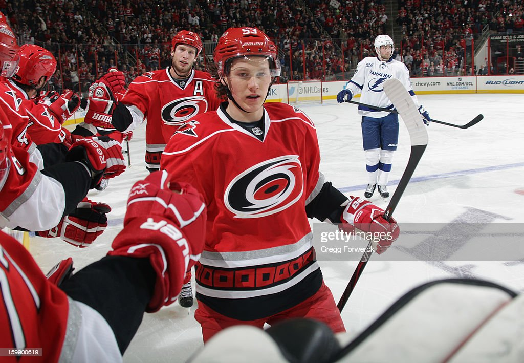 Jeff Skinner #53 of the Carolina Hurricanes is celebrates his second-period goal with teammates at the bench during an NHL game against the Tampa Bay Lightning on January 22, 2013 at PNC Arena in Raleigh, North Carolina.