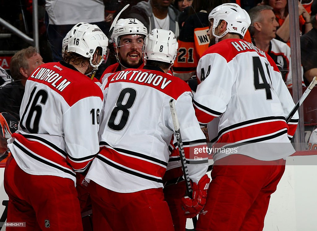 Jeff Skinner #53 of the Carolina Hurricanes is congratulated by teammates Elias Lindholm #16,Andrei Loktionov #8,Justin Faulk #27 and Jay Harrison #33 in the third period against the Philadelphia Flyers at Wells Fargo Center on April 13, 2014 in Philadelphia, Pennsylvania.The Carolina Hurricanes defeated the Philadelphia Flyers 6-5 in an overtime shootout.