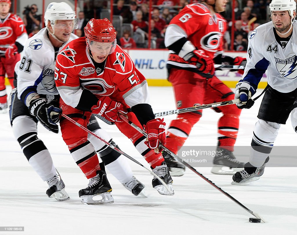 <a gi-track='captionPersonalityLinkClicked' href=/galleries/search?phrase=Jeff+Skinner&family=editorial&specificpeople=3147596 ng-click='$event.stopPropagation()'>Jeff Skinner</a> #53 of the Carolina Hurricanes is defended by <a gi-track='captionPersonalityLinkClicked' href=/galleries/search?phrase=Steven+Stamkos&family=editorial&specificpeople=4047623 ng-click='$event.stopPropagation()'>Steven Stamkos</a> #91 of the Tampa Bay Lightning during an NHL game on March 26, 2011 at RBC Center in Raleigh, North Carolina.