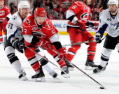 Jeff Skinner of the Carolina Hurricanes is defended by Steven Stamkos of the Tampa Bay Lightning during an NHL game on March 26 2011 at RBC Center in...