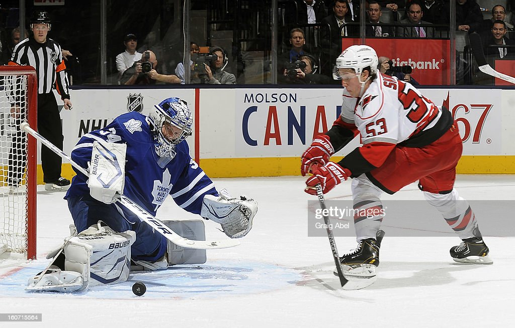Jeff Skinner #53 of the Carolina Hurricanes is stopped in close by James Reimer #34 of the Toronto Maple Leafs during NHL game action February 4, 2013 at the Air Canada Centre in Toronto, Ontario, Canada.