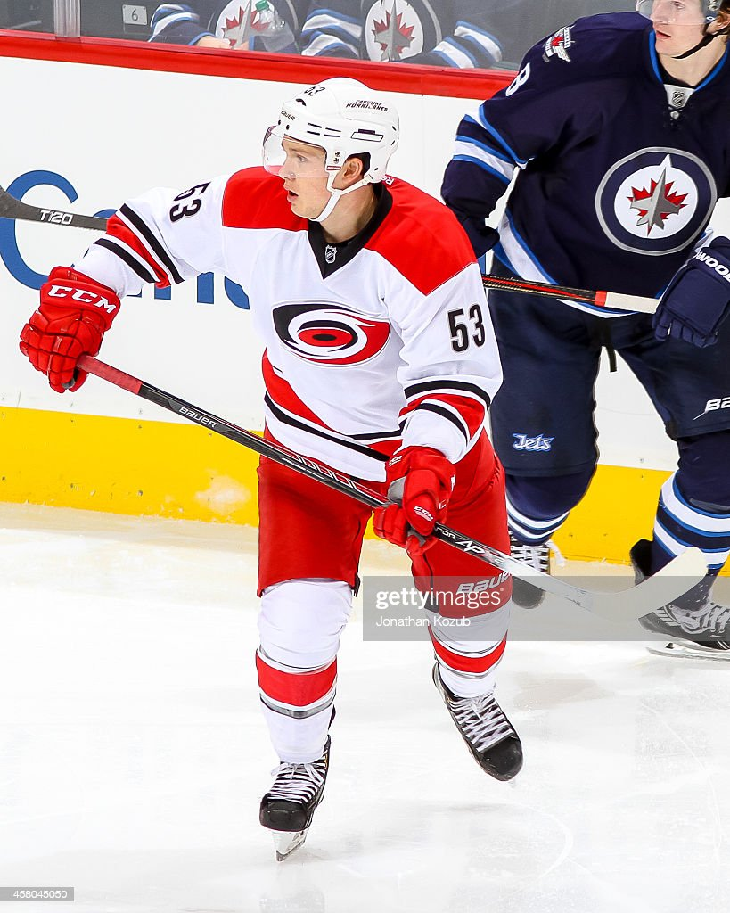 Jeff Skinner of the Carolina Hurricanes keeps an eye on the play during second period action against the Winnipeg Jets on October 21 2014 at the MTS...