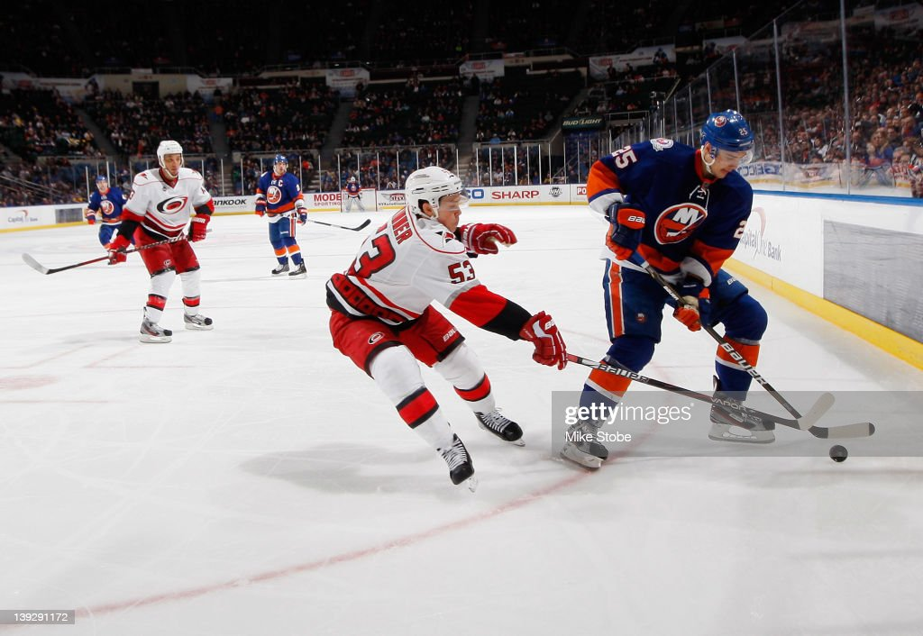 <a gi-track='captionPersonalityLinkClicked' href=/galleries/search?phrase=Jeff+Skinner&family=editorial&specificpeople=3147596 ng-click='$event.stopPropagation()'>Jeff Skinner</a> #53 of the Carolina Hurricanes lunges to knock the puck away from <a gi-track='captionPersonalityLinkClicked' href=/galleries/search?phrase=Nino+Niederreiter&family=editorial&specificpeople=6667732 ng-click='$event.stopPropagation()'>Nino Niederreiter</a> #25 of the New York Islanders at Nassau Veterans Memorial Coliseum on February 18, 2012 in Uniondale, New York. The Islanders defeated the Hurricanes 4-3.