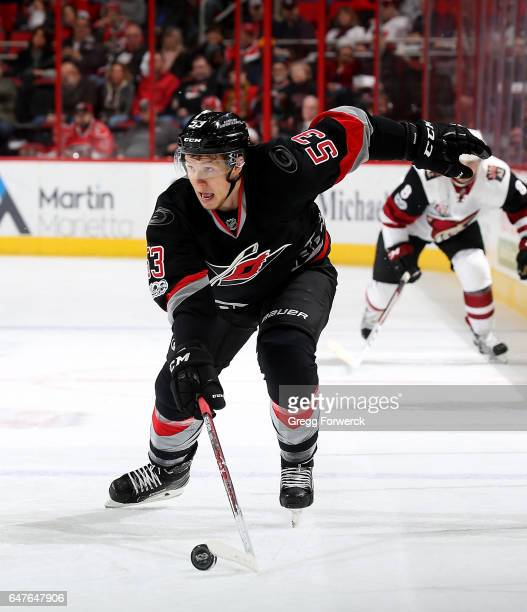 Jeff Skinner of the Carolina Hurricanes moves the puck across the blue line into the offensive zone during an NHL game against the Arizona Coyotes on...