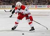 Jeff Skinner of the Carolina Hurricanes moves the puck against the Pittsburgh Penguins at Consol Energy Center on November 28 2014 in Pittsburgh...