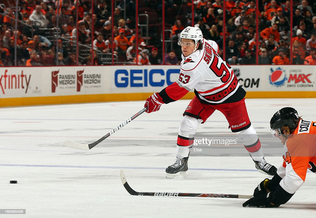 <a gi-track='captionPersonalityLinkClicked' href=/galleries/search?phrase=Jeff+Skinner&family=editorial&specificpeople=3147596 ng-click='$event.stopPropagation()'>Jeff Skinner</a> #53 of the Carolina Hurricanes passes the puck as <a gi-track='captionPersonalityLinkClicked' href=/galleries/search?phrase=Sean+Couturier&family=editorial&specificpeople=5663953 ng-click='$event.stopPropagation()'>Sean Couturier</a> #14 of the Philadelphia Flyers defends on February 2, 2013 at the Wells Fargo Center in Philadelphia, Pennsylvania.The Philadelphia Flyers defeated the Carolina Hurricanes 5-3.