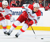 Jeff Skinner of the Carolina Hurricanes plays the puck against the New Jersey Devils at the Prudential Center on December 23 2014 in Newark New...
