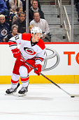 Jeff Skinner of the Carolina Hurricanes plays the puck up the ice during first period action against the Winnipeg Jets on October 21 2014 at the MTS...