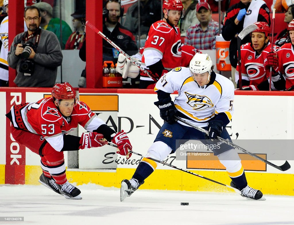 Jeff Skinner of the Carolina Hurricanes pokes the puck away from Gabriel Bourque of the Nashville Predators during play at the RBC Center on February...
