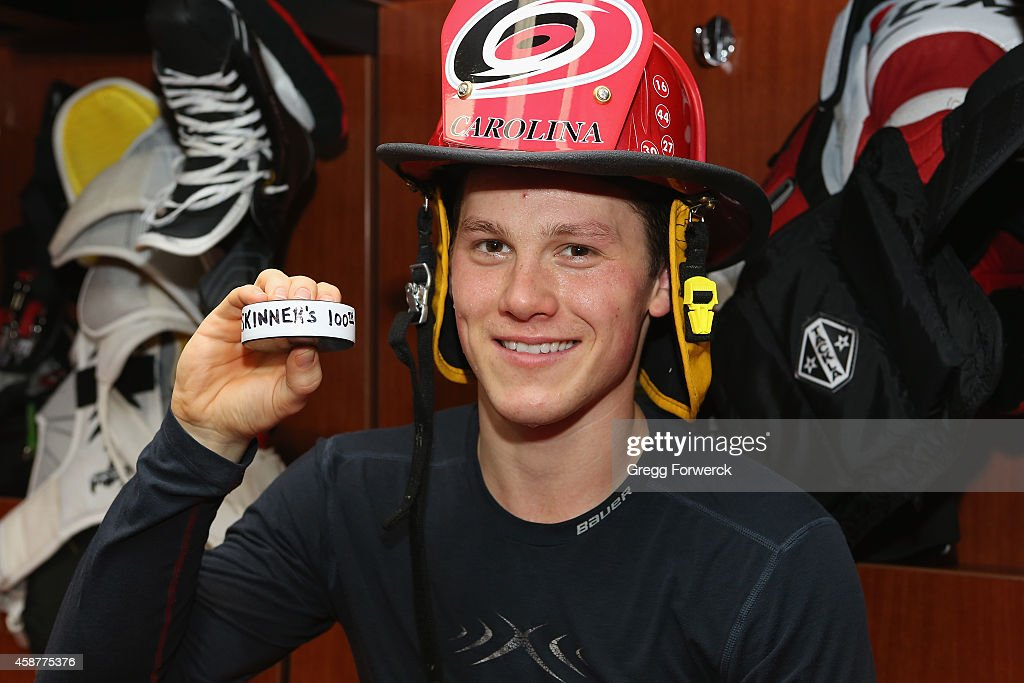 Jeff Skinner of the Carolina Hurricanes poses with his 100th NHL goal puck after an NHL game against the Calgary Flames at PNC Arena on November 10...
