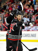 Jeff Skinner of the Carolina Hurricanes reacts after scoring a goal against the Phoenix Coyotes during the second period at PNC Arena on October 13...