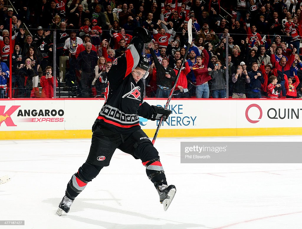 Jeff Skinner of the Carolina Hurricanes scores on a penalty shot in the third period of an NHL game against the New York Rangers on March 7 2014 at...