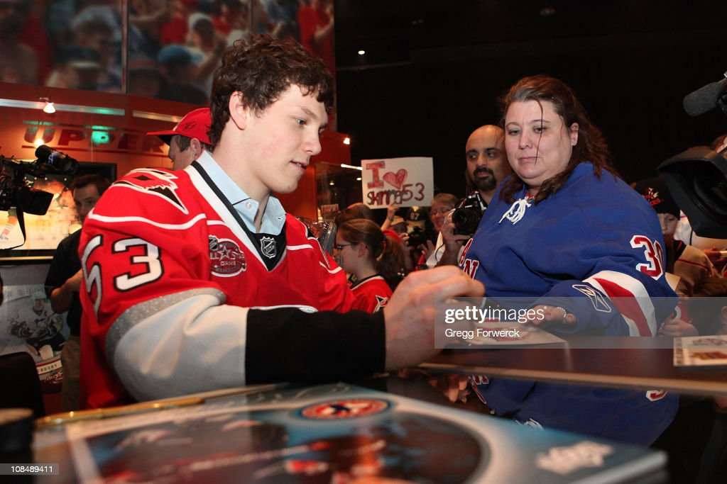 <a gi-track='captionPersonalityLinkClicked' href=/galleries/search?phrase=Jeff+Skinner&family=editorial&specificpeople=3147596 ng-click='$event.stopPropagation()'>Jeff Skinner</a> of the Carolina Hurricanes signs autographs for fans during the NHL Fan Fair part of 2011 NHL All-Star Weekend at the Raleigh Convention Center on January 28, 2011 in Raleigh, North Carolina.