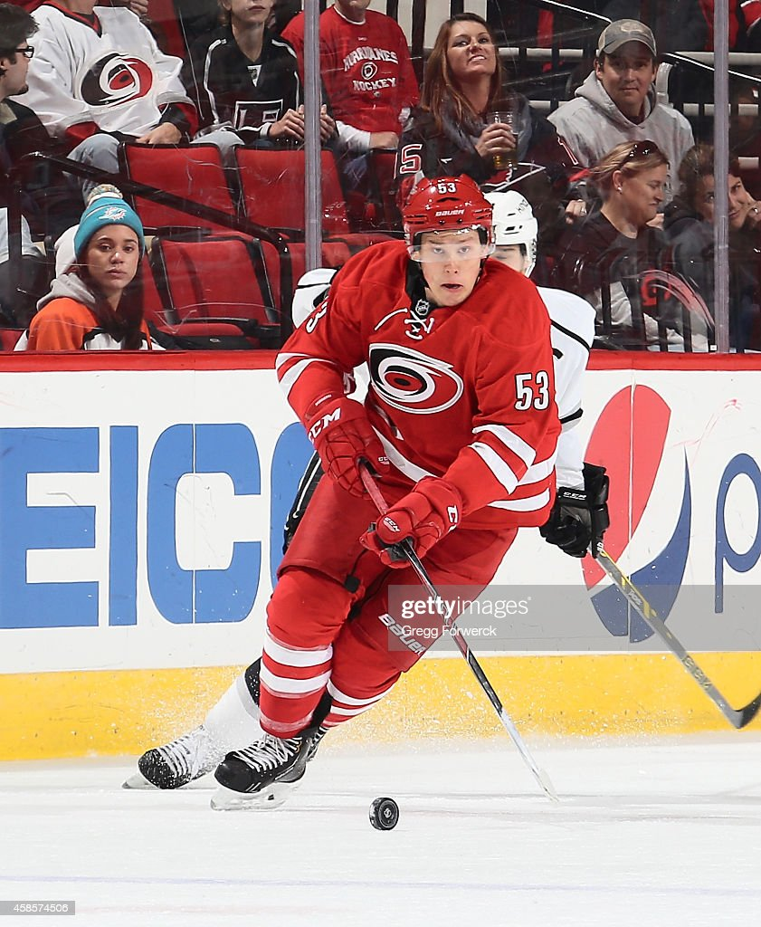 Jeff Skinner of the Carolina Hurricanes skates a loose puck up the ice during their NHL game against the Los Angeles Kings at PNC Arena on November 2...
