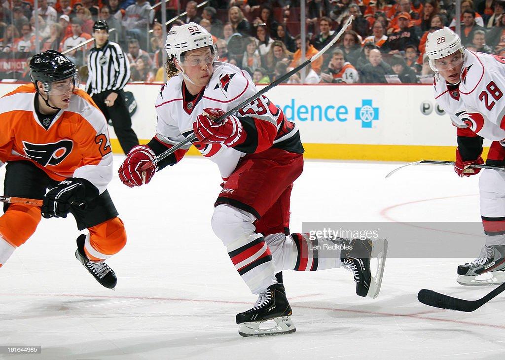 Jeff Skinner #53 of the Carolina Hurricanes skates against Matt Read #24 of the Philadelphia Flyers on February 9, 2013 at the Wells Fargo Center in Philadelphia, Pennsylvania.
