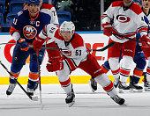 Jeff Skinner of the Carolina Hurricanes skates against the New York Islanders at the Nassau Veterans Memorial Coliseum on September 24 2014 in...