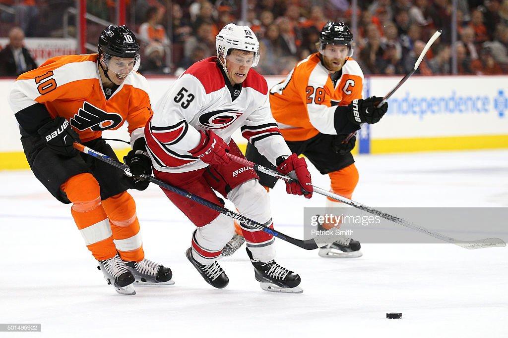 Jeff Skinner of the Carolina Hurricanes skates around Brayden Schenn of the Philadelphia Flyers in the first period at Wells Fargo Center on December...