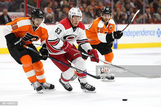 Jeff Skinner of the Carolina Hurricanes skates around Brayden Schenn of the Philadelphia Flyers in the first period at Wells Fargo Center on December...
