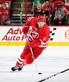 Jeff Skinner of the Carolina Hurricanes skates hard on the ice with the puck during a NHL game against the Florida Panthers at PNC Arena on October...