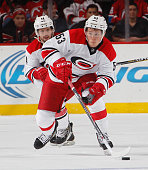 Jeff Skinner of the Carolina Hurricanes skates in an NHL hockey game against the New Jersey Devils at Prudential Center on December 23 2014 in Newark...