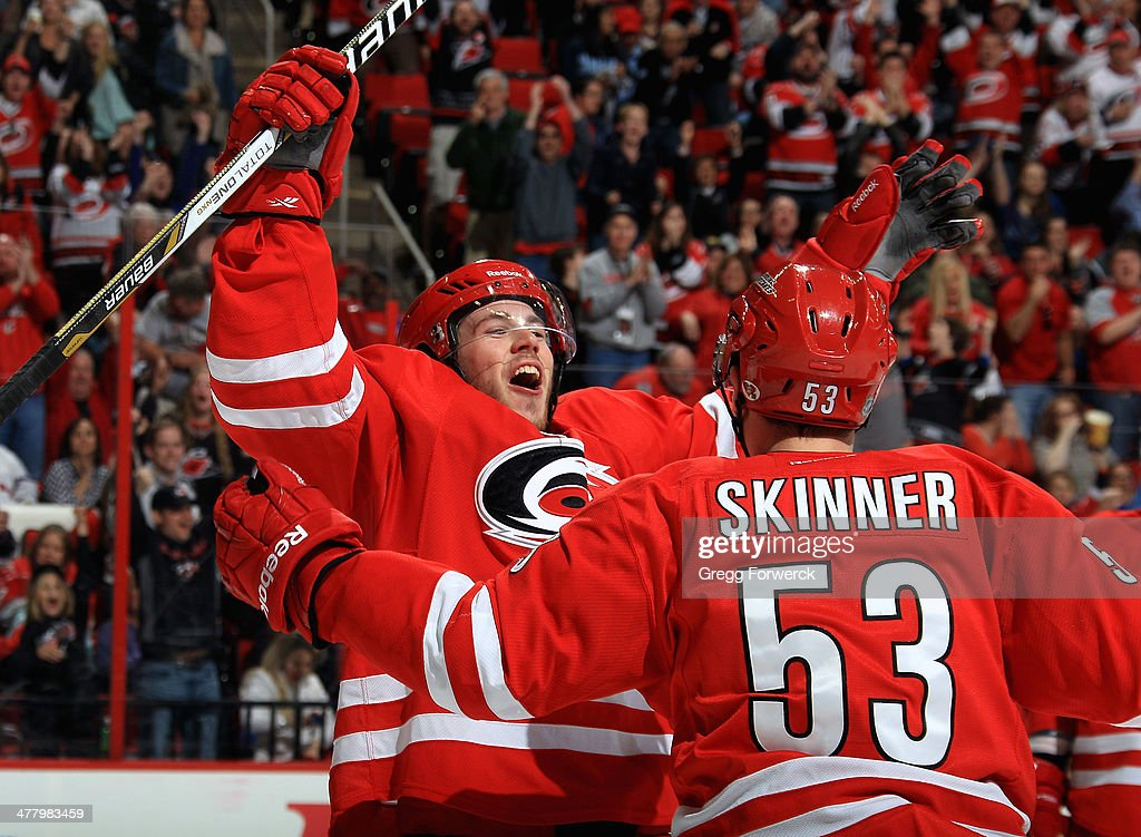 Jeff Skinner #53 of the Carolina Hurricanes skates in to embrace Elias Lindholm #16 after assisting on Lindholm's third-period tally to secure their victory over the New York Rangers during their NHL game at PNC Arena on March 11, 2014 in Raleigh, North Carolina.