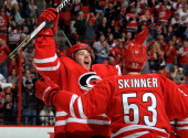 Jeff Skinner of the Carolina Hurricanes skates in to embrace Elias Lindholm after assisting on Lindholm's thirdperiod tally to secure their victory...