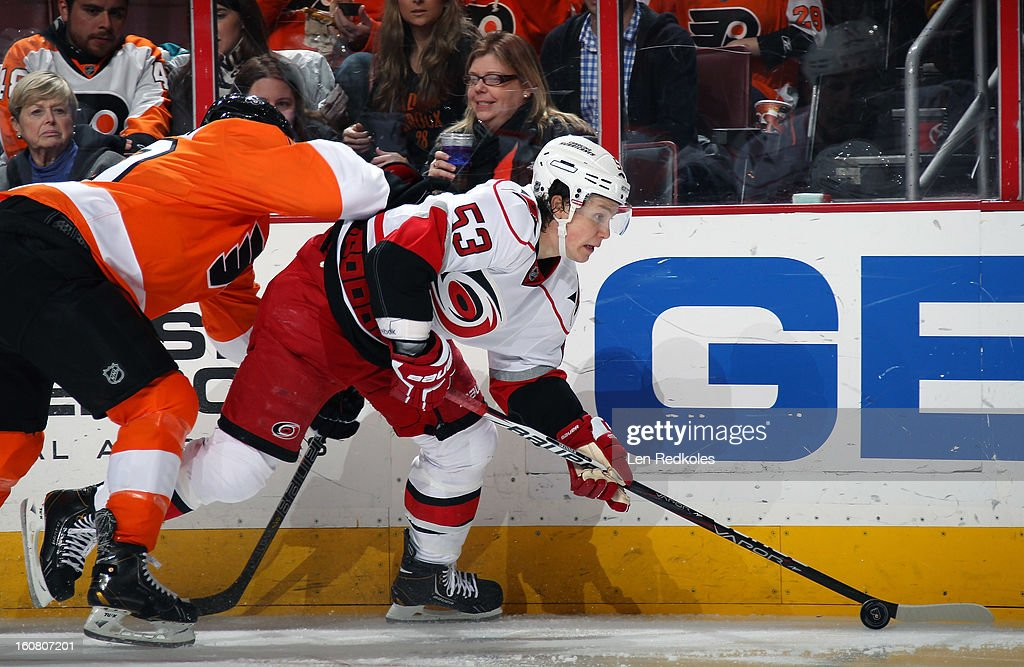 Jeff Skinner #53 of the Carolina Hurricanes skates the puck against a member of the Philadelphia Flyers on February 2, 2013 at the Wells Fargo Center in Philadelphia, Pennsylvania.