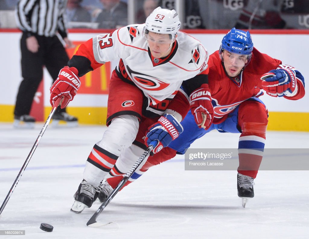 <a gi-track='captionPersonalityLinkClicked' href=/galleries/search?phrase=Jeff+Skinner&family=editorial&specificpeople=3147596 ng-click='$event.stopPropagation()'>Jeff Skinner</a> #53 of the Carolina Hurricanes skates with puck around defenceman <a gi-track='captionPersonalityLinkClicked' href=/galleries/search?phrase=Alexei+Emelin&family=editorial&specificpeople=723573 ng-click='$event.stopPropagation()'>Alexei Emelin</a> #74 of the Montreal Canadiens during the NHL game on April 1, 2013 at the Bell Centre in Montreal, Quebec, Canada.