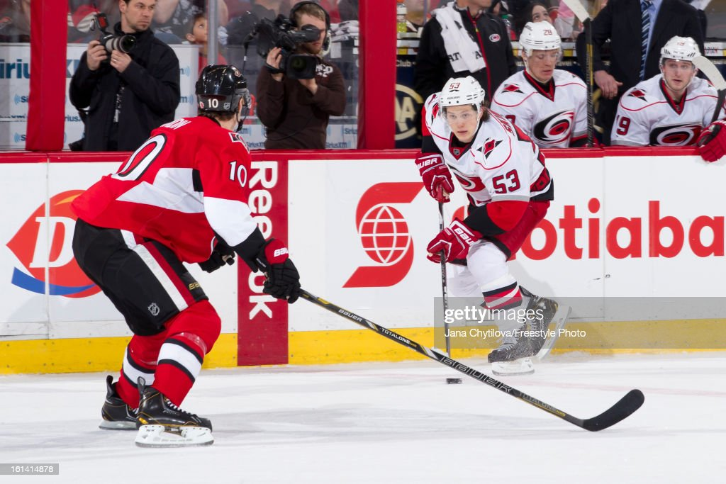 Jeff Skinner #53 of the Carolina Hurricanes skates with the puck against Mike Lundin #10 of the Ottawa Senators during an NHL game at Scotiabank Place on February 7, 2013 in Ottawa, Ontario, Canada.