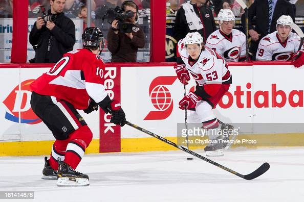Jeff Skinner of the Carolina Hurricanes skates with the puck against Mike Lundin of the Ottawa Senators during an NHL game at Scotiabank Place on...