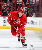 Jeff Skinner of the Carolina Hurricanes skates with the puck during their NHL game against the New Jersey Devils at PNC Arena on March 28 2015 in...