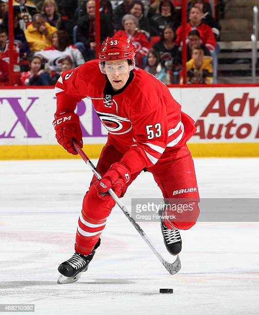 Jeff Skinner of the Carolina Hurricanes skates with the puck during their NHL game against the Boston Bruins at PNC Arena on March 29 2015 in Raleigh...