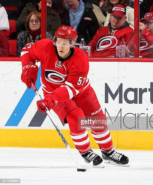 Jeff Skinner of the Carolina Hurricanes skates with the puck during an NHL game against the New York Islanders at PNC Arena on February 13 2016 in...