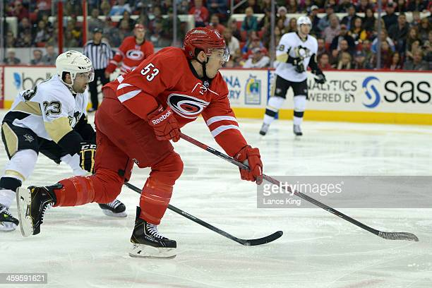 Jeff Skinner of the Carolina Hurricanes takes a shot on goal against the Pittsburgh Penguins at PNC Arena on December 27 2013 in Raleigh North...