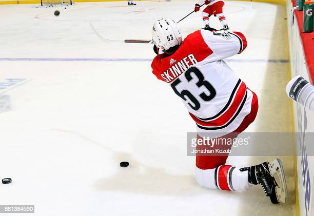 Jeff Skinner of the Carolina Hurricanes takes a shot on goal during the pregame warm up prior to NHL action against the Winnipeg Jets at the Bell MTS...