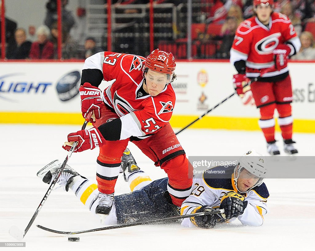Jeff Skinner #53 of the Carolina Hurricanes takes the puck away from Jason Pominville #29 of the Buffalo Sabres during play at PNC Arena on January 24, 2013 in Raleigh, North Carolina.