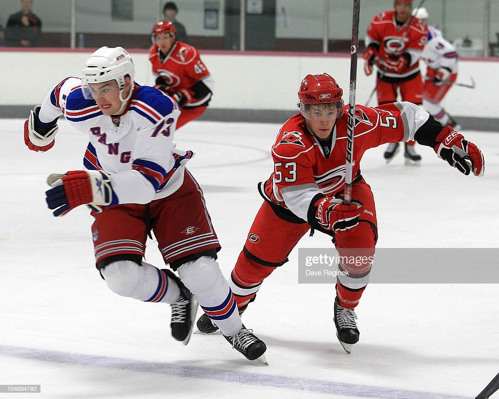 Jeff Skinner of the Carolina Hurricanes tries to skate past the defence of Dylan Mcllrath of the New York Rangers during the NHL Prospects Tournament...