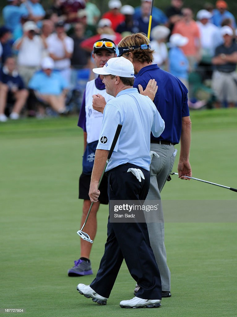 <a gi-track='captionPersonalityLinkClicked' href=/galleries/search?phrase=Jeff+Sluman&family=editorial&specificpeople=217270 ng-click='$event.stopPropagation()'>Jeff Sluman</a> and <a gi-track='captionPersonalityLinkClicked' href=/galleries/search?phrase=Brad+Faxon&family=editorial&specificpeople=215316 ng-click='$event.stopPropagation()'>Brad Faxon</a> exit the 18th green during the final round of the Legends Division at the Liberty Mutual Insurance Legends of Golf at The Westin Savannah Harbor Golf Resort & Spa on April 28, 2013 in Savannah, Georgia.