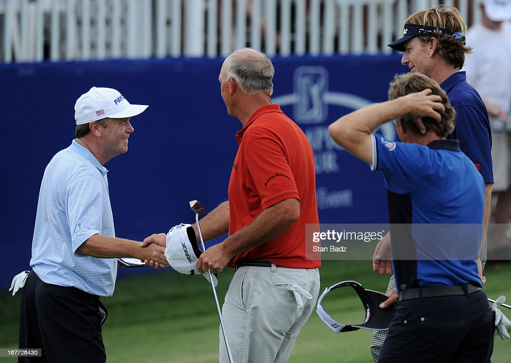 <a gi-track='captionPersonalityLinkClicked' href=/galleries/search?phrase=Jeff+Sluman&family=editorial&specificpeople=217270 ng-click='$event.stopPropagation()'>Jeff Sluman</a>, <a gi-track='captionPersonalityLinkClicked' href=/galleries/search?phrase=Tom+Lehman&family=editorial&specificpeople=184539 ng-click='$event.stopPropagation()'>Tom Lehman</a>, <a gi-track='captionPersonalityLinkClicked' href=/galleries/search?phrase=Brad+Faxon&family=editorial&specificpeople=215316 ng-click='$event.stopPropagation()'>Brad Faxon</a>, and <a gi-track='captionPersonalityLinkClicked' href=/galleries/search?phrase=Bernhard+Langer&family=editorial&specificpeople=167071 ng-click='$event.stopPropagation()'>Bernhard Langer</a> all exit the 18th green during the final round of the Legends Division at the Liberty Mutual Insurance Legends of Golf at The Westin Savannah Harbor Golf Resort & Spa on April 28, 2013 in Savannah, Georgia.