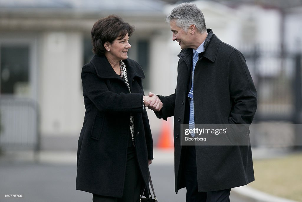 Jeff Smisek, chief executive officer of United Continental Holdings Inc., right, shakes hands with Monica Lozano, chief executive officer of ImpreMedia LLC, as they arrive to the White House to meet with U.S. President Barack Obama in Washington, D.C., U.S., on Tuesday, Feb. 5, 2013. Obama urged Congress to postpone automatic spending cuts scheduled to begin March 1 to avoid 'real and lasting impacts' on U.S. economic growth. Photographer: Andrew Harrer/Bloomberg via Getty Images