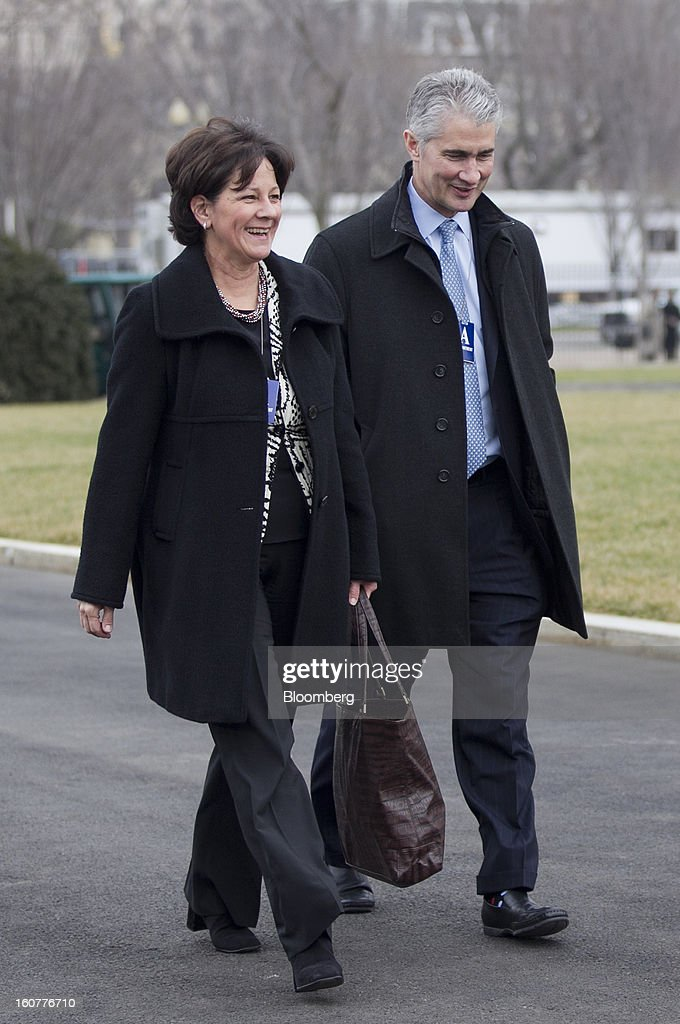 Jeff Smisek, chief executive officer of United Continental Holdings Inc., right, and Monica Lozano, chief executive officer of ImpreMedia LLC, arrive to the White House to meet with U.S. President Barack Obama in Washington, D.C., U.S., on Tuesday, Feb. 5, 2013. Obama urged Congress to postpone automatic spending cuts scheduled to begin March 1 to avoid 'real and lasting impacts' on U.S. economic growth. Photographer: Andrew Harrer/Bloomberg via Getty Images