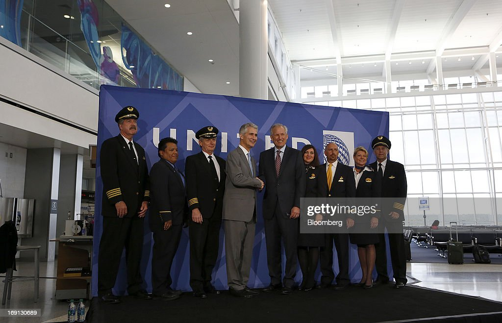Jeff Smisek, chief executive officer of United Continental Holdings Inc., center left, and James McNerney, chairman, president and chief executive officer of Boeing Co., center right, pose with a flight crew following a news conference at George Bush Intercontinental Airport in Houston, Texas, U.S., on Monday, May 20, 2013. Smisek and McNerney departed on United Flight 1 from Houston en route for Chicago. Boeing Co.'s 787 Dreamliner is poised to clear another hurdle in restoring its image as United Airlines, the only U.S. operator, resumes flights after the jet's lithium-ion battery flaws forced a three-month grounding. Photographer: Aaron M. Sprecher/Bloomberg via Getty Images