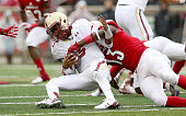 Jeff Smith of the Boston College Eagles is sacked by James Burgess of the Louisville Cardinalsat Papa John's Cardinal Stadium on October 24 2015 in...