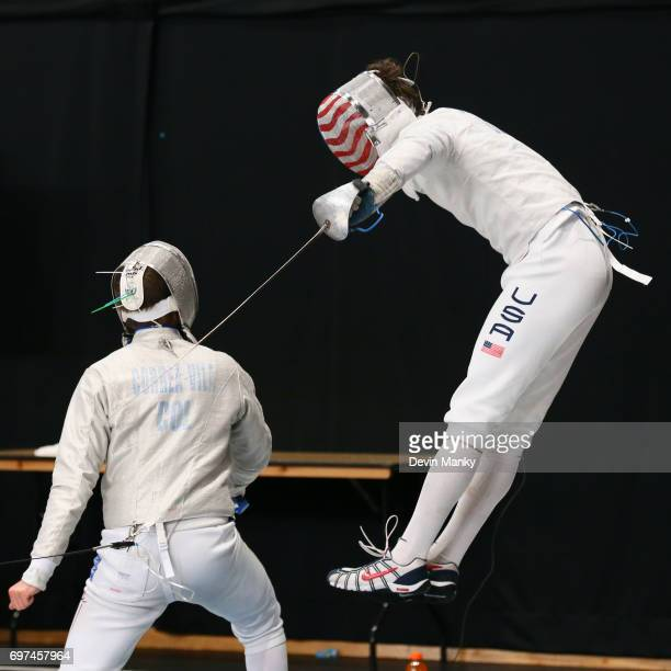 Jeff Spear of the USA leaps into the air while attacking Carlos Correa Vila of Colombia during the Team Men's Sabre event on June 18 2017 at the...